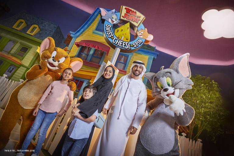 Image of Tom & Jerry & family in the warner bros. world posing for the photo