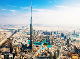 Image of Burj Khalifa the worlds tallest building in Dubai - UAE's with other buildings in the surrounding