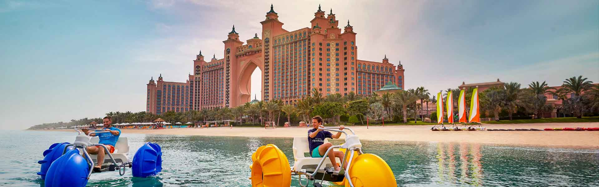 Banner image of Hotel Atlantis and tourist enjoying in the beach