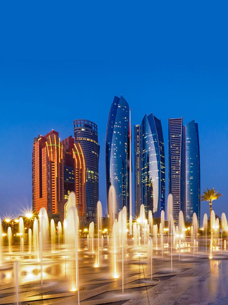 Banner image of beautiful view of building and water fountain with palm tree